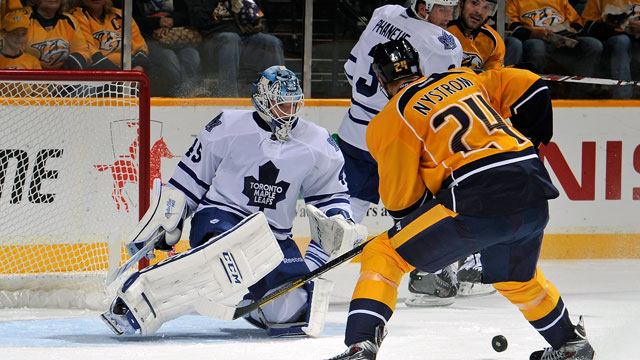 b91c7f9ba32 Eric Nystrom  24 of the Nashville Predators tries to get a rebound in front  of goalie Jonathan Bernier  45 of the Toronto Maple Leafs at Bridgestone  Arena ...