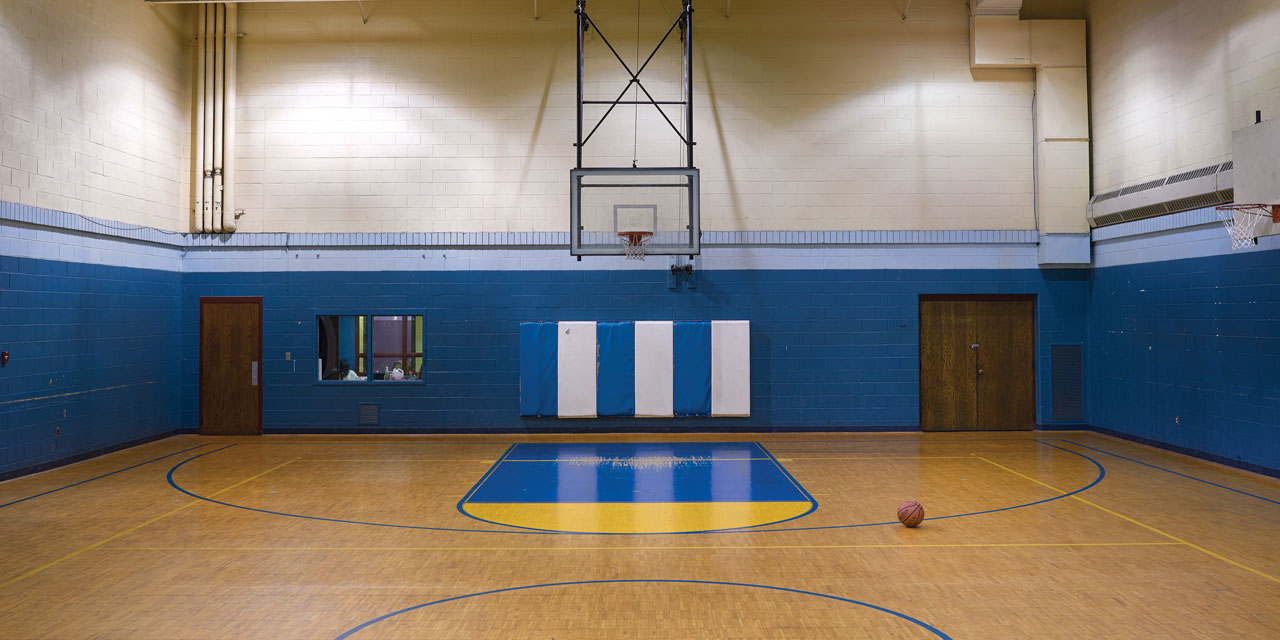 The Court Is Exactly As He Left It Same Dark Blue Walls Paint Of Keys Chipped Away Under Baskets Two Rows Inset Bleachers