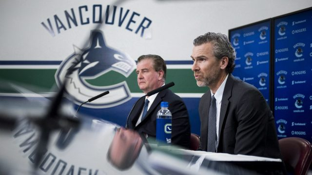 Vancouver-Canucks-general-manager-Jim-Benning-(left)-and-Trevor-Linden,-president-of-hockey-operations,-hold-a-media-presser-to-announce-that-coach-Willie-Desjardins-will-be-relieved-of-duties,-in-Vancouver,-B.C.-on-Monday,-April-10,-2017.-(Jimmy-Jeong/CP)