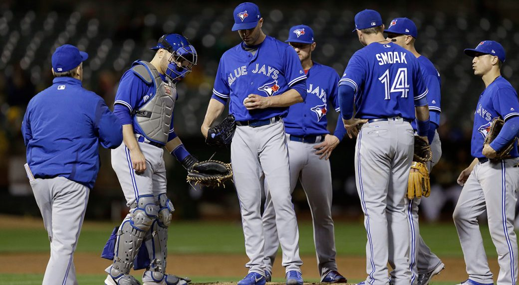 Hahn returns from DL to pitch Athletics past Blue Jays 4-1