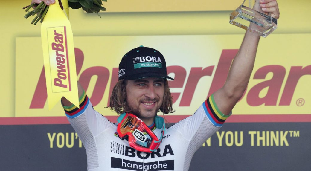 6687908fc Stage winner Peter Sagan of Slovakia celebrates on the podium after the  third stage of the Tour de France cycling race over 212.5 kilometers (132  miles) ...