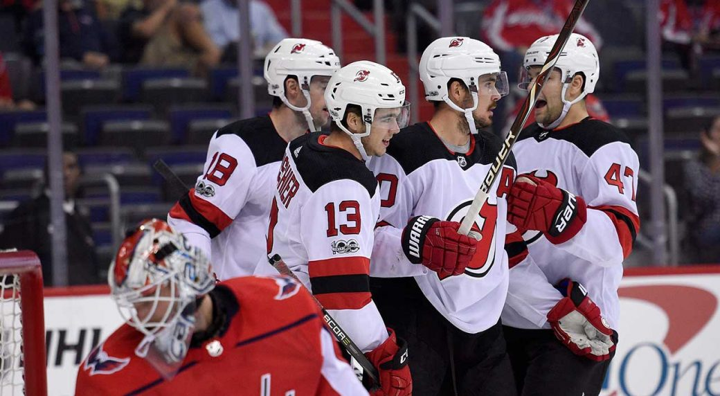 6de103165 New Jersey Devils centre Nico Hischier (13) celebrates his goal with John  Quenneville (47), Marcus Johansson, second from right, and Drew Stafford (18)  as ...
