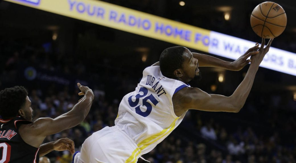 6d7759835383 Golden State Warriors  Kevin Durant (35) passes away from Miami Heat  forward Justise Winslow during the second half of an NBA basketball game  Monday