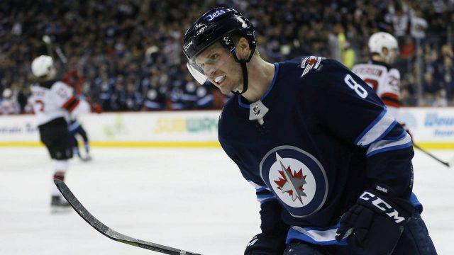 Winnipeg-Jets'-Jacob-Trouba-(8)-celebrates-his-goal-against-the-New-Jersey-Devils-during-the-second-period-NHL-action-in-Winnipeg-on-Saturday,-November-18,-2017.-(John-Woods/CP)