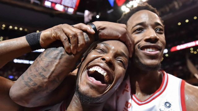 Toronto-Raptors'-Kyle-Lowry,-left,-and-DeMar-DeRozan-celebrate-after-defeating-the-Milwaukee-Bucks-in-NBA-basketball-action-in-Toronto-on-Monday,-January-1,-2018.-(Frank-Gunn/CP)