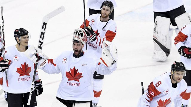 Canada-goaltender-Kevin-Poulin-(31)-celebrates-their-bronze-medal-win-with-teammates-following-third-period-men's-hockey-bronze-medal-game-action-against-Czech-Republic-at-the-2018-Olympic-Winter-Games,-in-Pyeongchang,-South-Korea,-on-Saturday,-February-24,-2018.-(Nathan-Denette/CP)