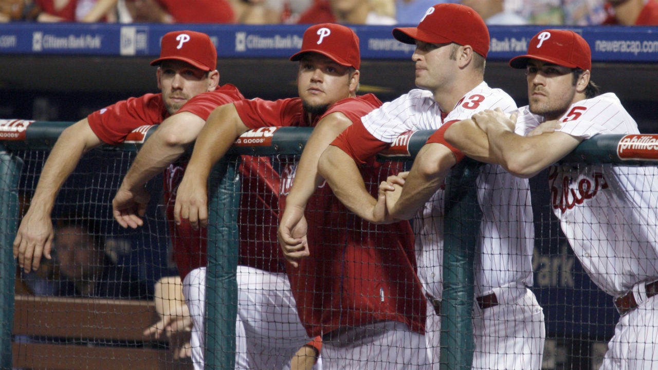 Philadelphia Phillies starting pitchers, left to right, Cliff Lee, Joe Blanton, A.J. Happ and Cole Hamels watch from the dugout in 2009.