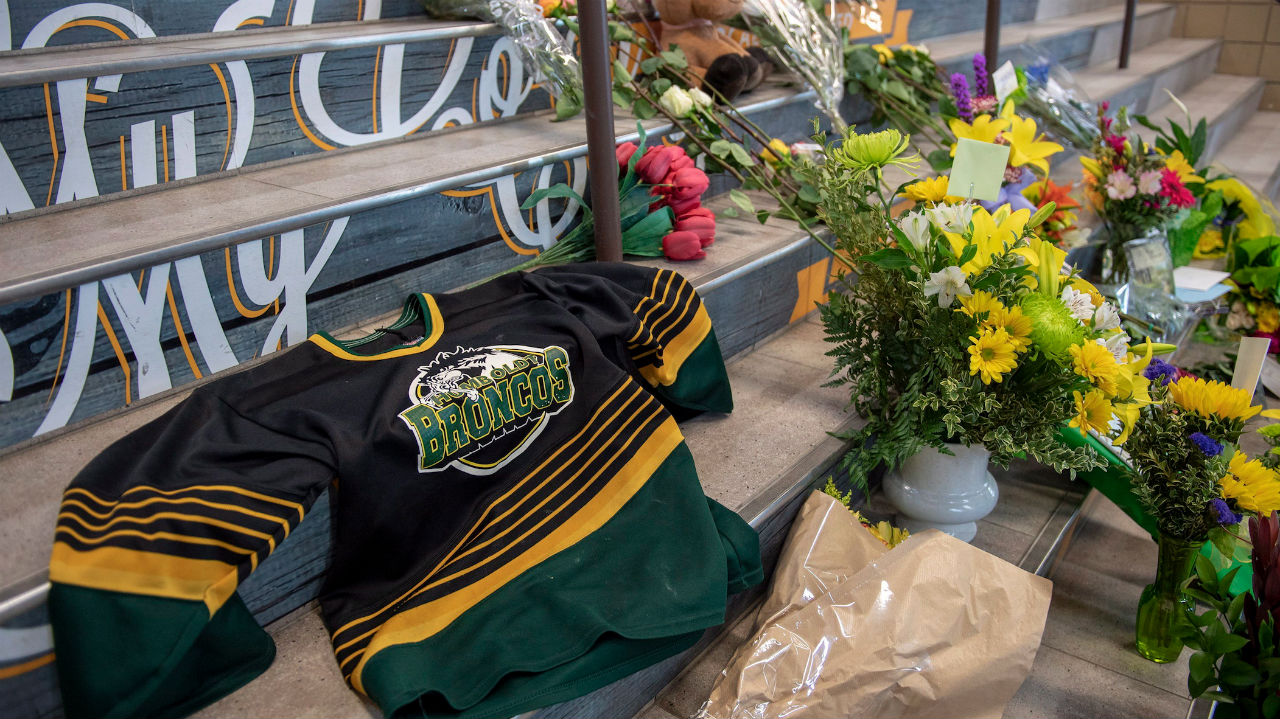 memorial at the stairs that lead to Elgar Petersen Arena is shown in Humboldt, Sask., on Saturday, April 7, 2018. RCMP say 14 people are dead and 14 people were injured Friday after a truck collided with a bus carrying a junior hockey team to a playoff game in northeastern Saskatchewan. Police say there were 28 people including the driver on board the Humboldt Broncos bus when the crash occurred at around 5 p.m. on Highway 35 north of Tisdale. THE CANADIAN PRESS/Liam Richards