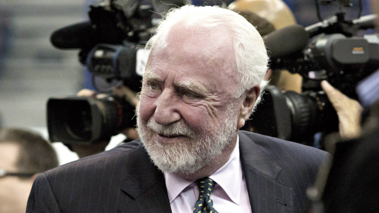 Former Edmonton Oilers owner Peter Pocklington and his company face new securities charges in the United States. The Securities and Exchange Commission has charged Pocklington, his medical device company and others with defrauding investors by hiding his previous charges and misappropriating investor funds. Pocklington is seen making his way to the 1984 Stanley Cup Reunion media availability in Edmonton on Wednesday, October 8, 2014. (Jason Franson/CP)