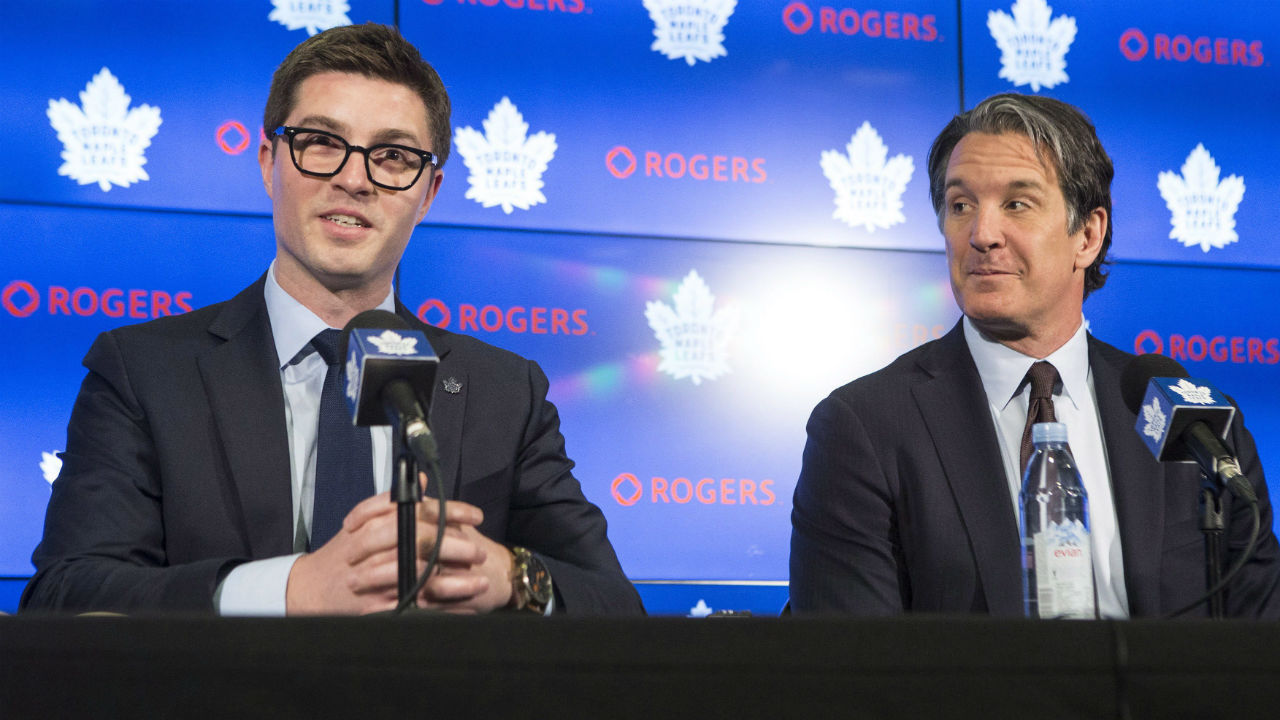 Newly-appointed Toronto Maple Leafs general manager Kyle Dubas, left, sits alongside president and alternate governor Brendan Shanahan during a news conference in Toronto on Friday, May 11, 2018. (Chris Young/CP)