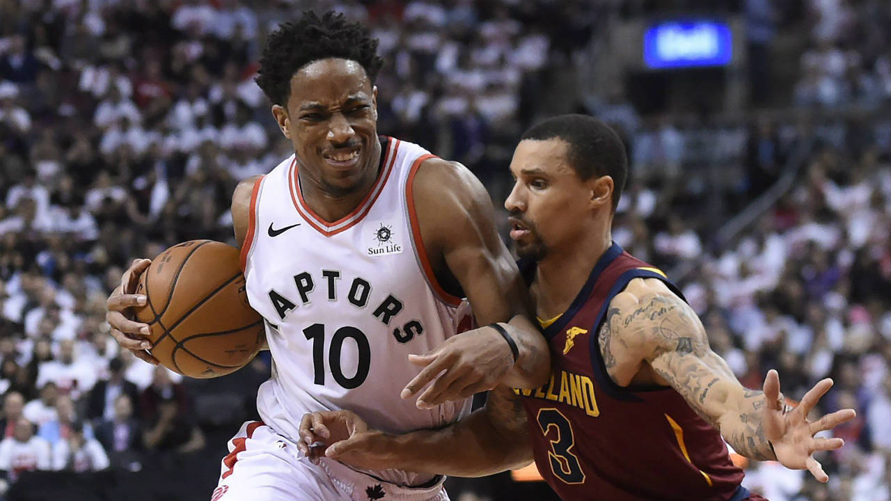 Toronto Raptors guard DeMar DeRozan (10) battles Cleveland Cavaliers guard George Hill (3) in Toronto on Tuesday, May 1, 2018. (Nathan Denette/CP)