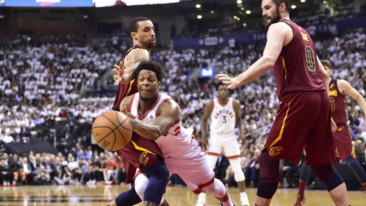 Toronto Raptors guard Kyle Lowry (7) passes around Cleveland Cavaliers guard J.R. Smith (5) in Toronto on Thursday, May 3, 2018. (Frank Gunn/CP)