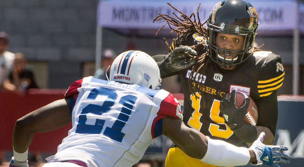 Montreal Alouettes linebacker Chris Ackie closes in on Hamilton Tiger-Cats  running back Alex Green during first half preseason CFL football in  Montreal. 009cbd5fd