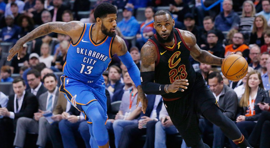 5f0ca0498c9d Cleveland Cavaliers forward LeBron James (23) drives past Oklahoma City  Thunder forward Paul George (13) during the first half of an NBA basketball  game in ...