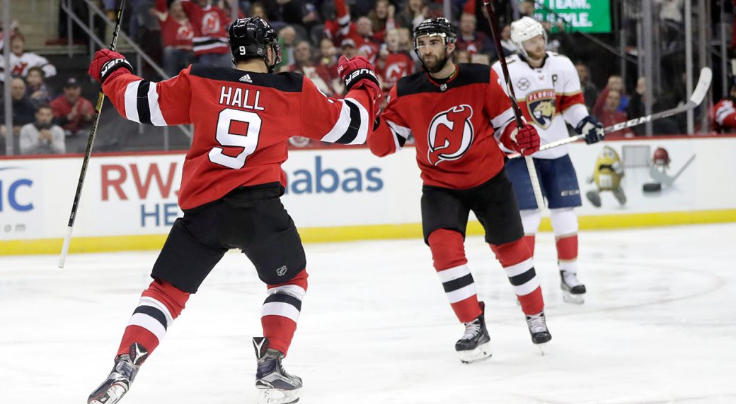 New Jersey Devils left wing Taylor Hall (9) celebrates his goal against the  Florida Panthers with teammate Kyle Palmieri eca0ee442