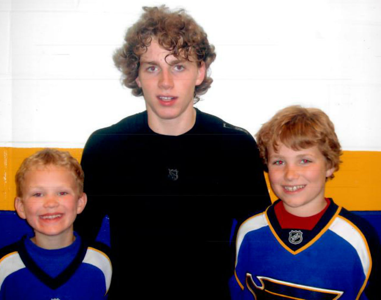 Patrick Kane poses with a young Brady (L) and Matthew Tkachuk.