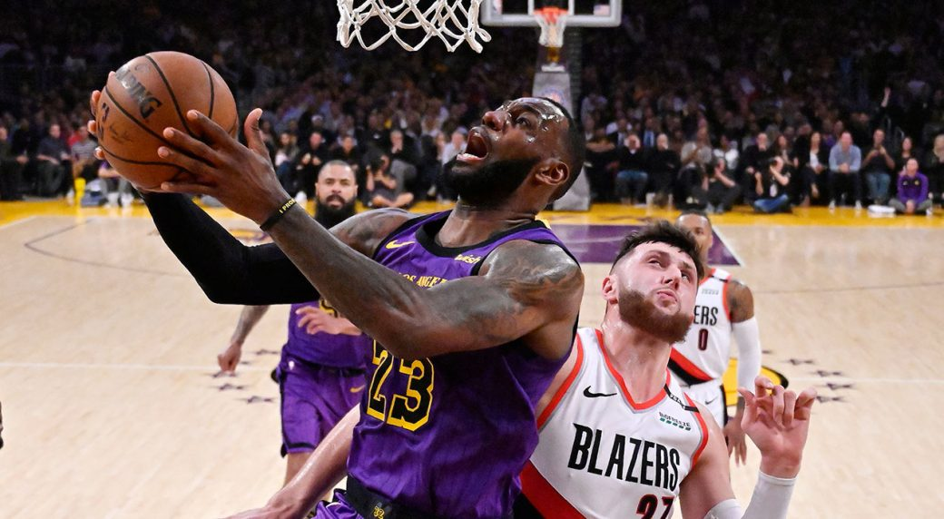 0071571d4 Los Angeles Lakers forward LeBron James shoots as Portland Trail Blazers  center Jusuf Nurkic defends during the second half of an NBA basketball  game ...