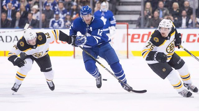 patrick-marleau-drives-between-chris-wagner-and-connor-clifton