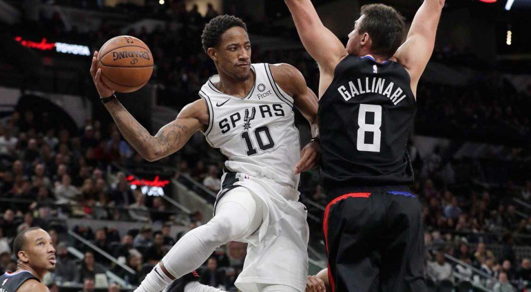 e0812db0ea00 San Antonio Spurs guard DeMar DeRozan (10) drives past Los Angeles Clippers  forward Danilo Gallinari (8) during the second half of an NBA basketball  game.