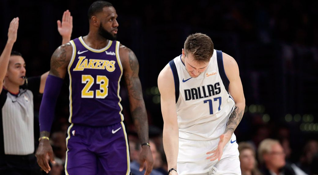 0451161f084 Dallas Mavericks  Luka Doncic (77) reacts after making a 3-point basket  next to Los Angeles Lakers  LeBron James (23) during the second half of an  NBA ...