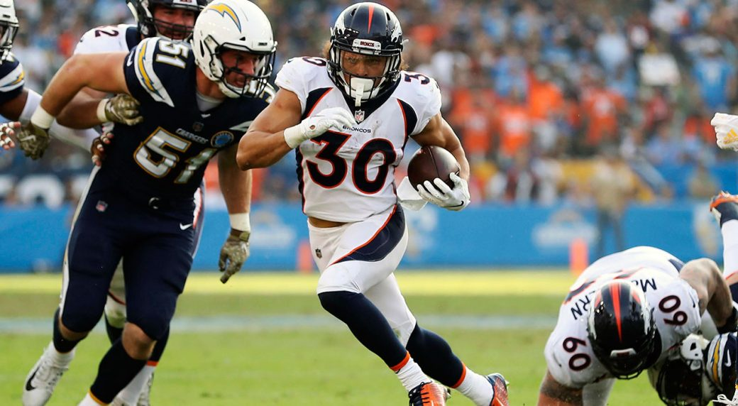 Denver Broncos running back Phillip Lindsay (30) runs against the Los  Angeles Chargers during an NFL football game 178d4f110