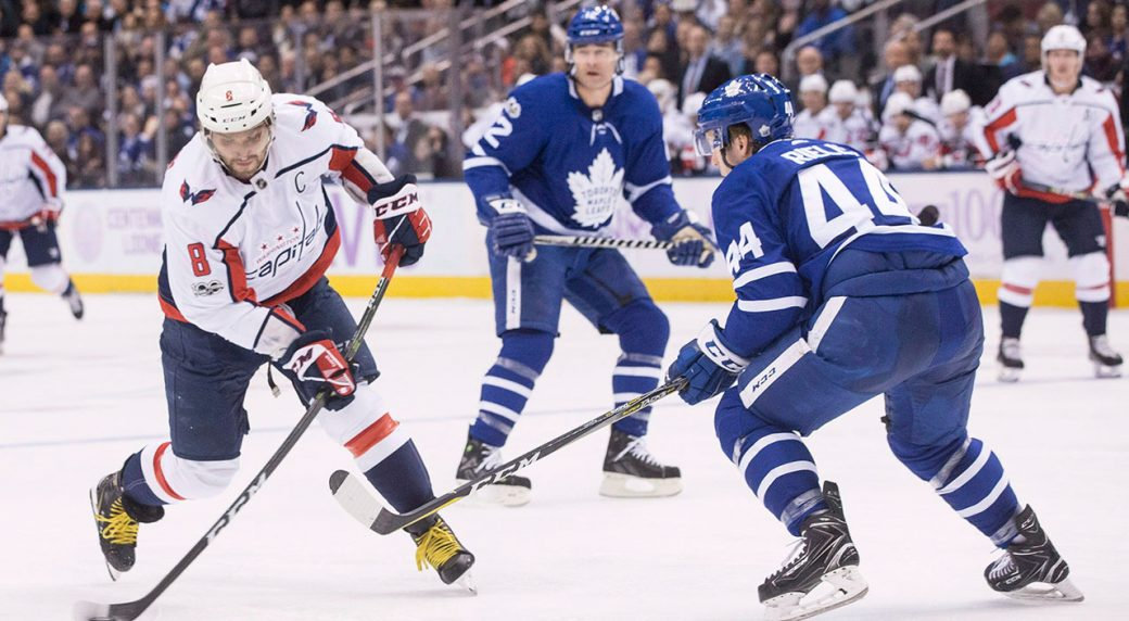c7cf387530f Washington Capitals  Alex Ovechkin (left) scores his team s first goal  against the Toronto Maple Leafs as Leafs defenceman Morgan Rielly defends  during ...