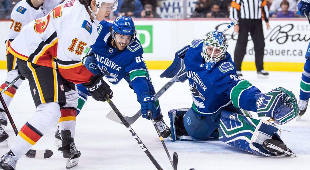 9d269a6b8 Calgary Flames  Spencer Foo (15) scores against Vancouver Canucks goalie  Thatcher Demko