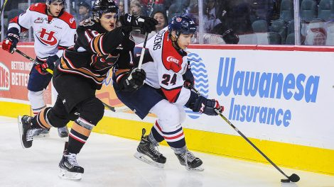 Dylan-Cozens-of-the-Lethbridge-Hurricanes-controls-the-puck