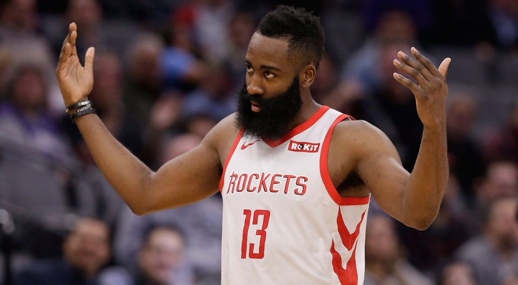 5e5df43928d2 Houston Rockets guard James Harden waves to the crowd during the second half  of the team s NBA basketball game against the Sacramento Kings.
