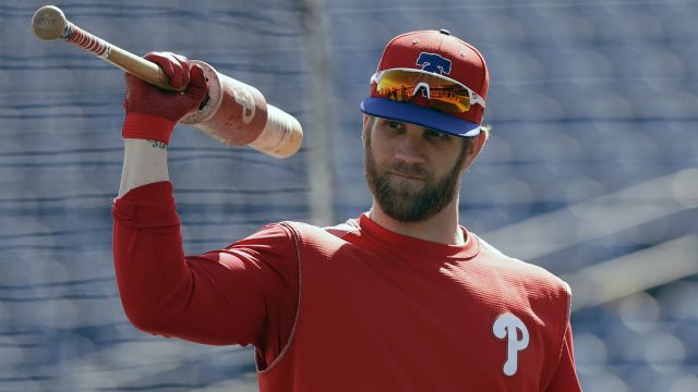 Philadelphia-Phillies'-Bryce-Harper-waits-his-turn-in-the-batting-cage-before-a-spring-training-baseball-game-against-the-Toronto-Blue-Jays-Saturday,-March-9,-2019,-in-Clearwater,-Fla.-(AP-Photo/Chris-O'Meara)