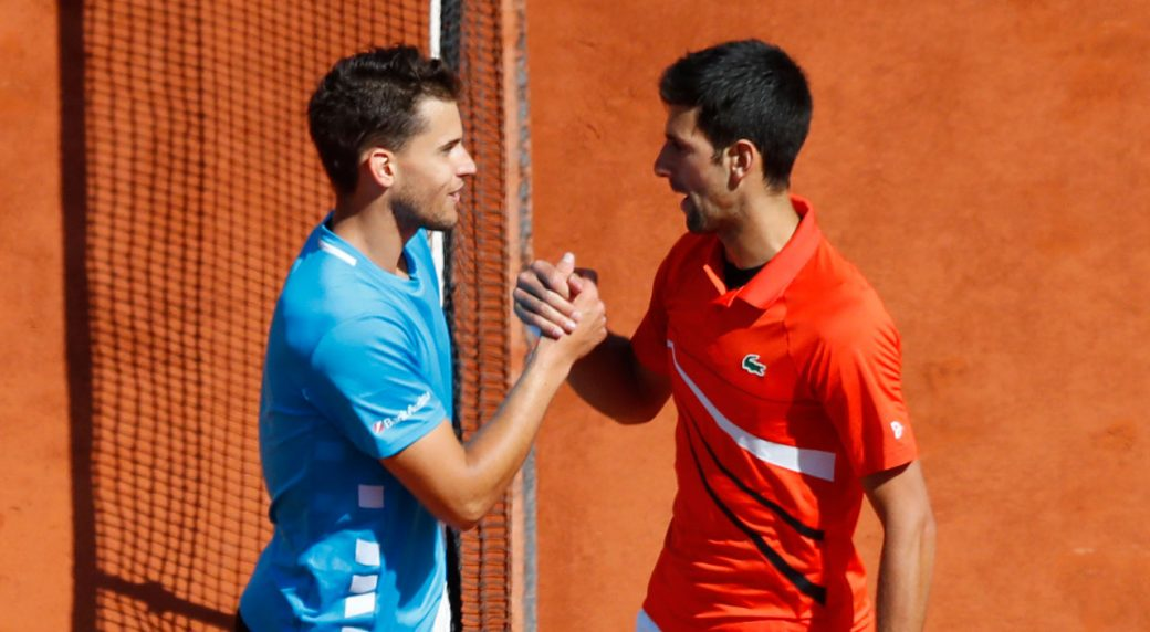 a47dd5f602c Austria's Dominic Thiem, left, is congratulated by Serbia's Novak Djokovic  after their men's semifinal match of the French Open tennis tournament at  the ...